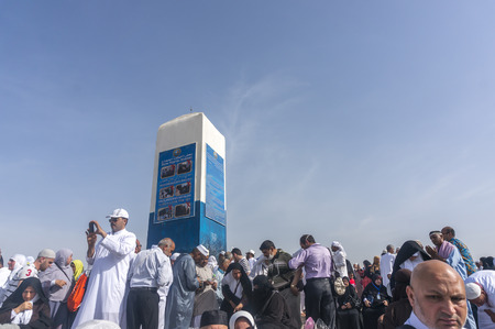 adam and eve: MECCA, SAUDI ARABIA - MAR 11: Muslims at Mount Arafat (or Jabal Rahmah) March 11, 2015 in Arafat, Saudi Arabia. This is the place where Adam and Eve met after being overthrown from heaven. Editorial