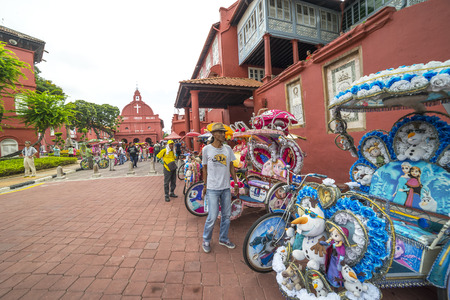 trishaw: MALACCA, MALAYSIA - DEC 4, 2015: Trishaw in front of Christ Church & Dutch Square in Malacca City, Malaysia. It was built in 1753 by Dutch & is the oldest 18th century Protestant church in Malaysia.