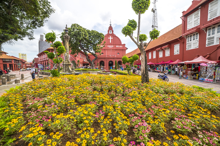 malaysia: MALACCA, MALAYSIA - DEC 4, 2015: Day view of Christ Church & Dutch Square in Malacca City, Malaysia. It was built in 1753 by Dutch & is the oldest 18th century Protestant church in Malaysia.