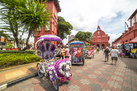 protestant: MALACCA, MALAYSIA - DEC 4, 2015: A row of trishaw in front of Christ Church & Dutch Square in Malacca City, Malaysia. It was built in 1753 by Dutch & is the oldest 18th century Protestant church in Malaysia.