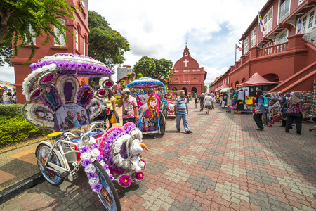trishaw: MALACCA, MALAYSIA - DEC 4, 2015: A row of trishaw in front of Christ Church & Dutch Square in Malacca City, Malaysia. It was built in 1753 by Dutch & is the oldest 18th century Protestant church in Malaysia.