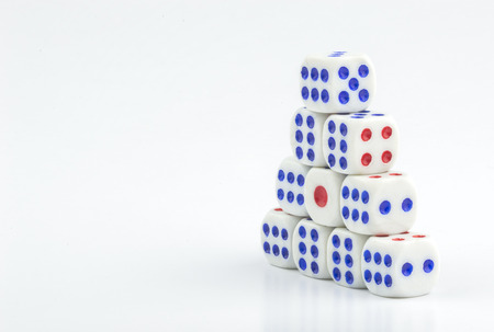 tossing: White dice stacking with close up view
