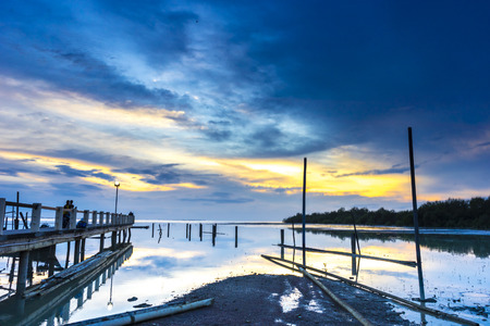 morning blue hour: Jetty silhouette with sunset background in blue hour view