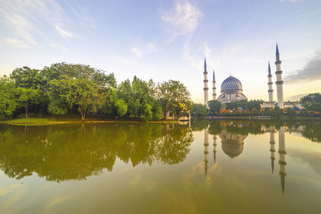 january sunrise: SELANGOR, MALAYSIA - JANUARY 30, 2016: The Beautiful Sultan Salahuddin Abdul Aziz Shah Mosque (also known as the Blue Mosque) with nature sunrise lighting and reflection.