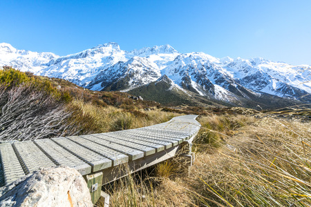 hooker: Hooker valley walking trek with sun flare at Mouth Cook, New Zealand Stock Photo