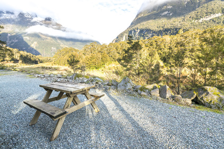 table mountain national park: Wooden bench with mountain background Stock Photo