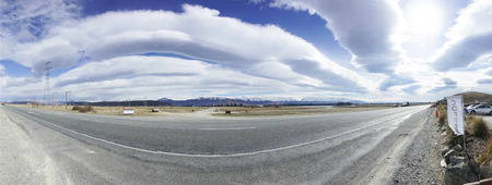 lenticular: TE ANAU, NEW ZEALAND - AUGUST 31, 2016 : Panaroma of asphalt road with lenticular cloud
