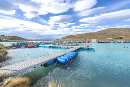 fish rearing: Salmon Fish farm floating on the glacial waters of Wairepo Arm, Twizel, South Island, New Zealand