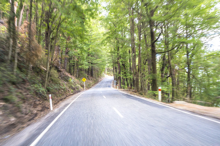 slow motion: Road along Lake Wakatipu, Queenstown, New Zealand with slow motion movement.