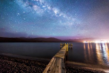 anau: Night milkyway with wooden jetty at Te Anau, New Zealand