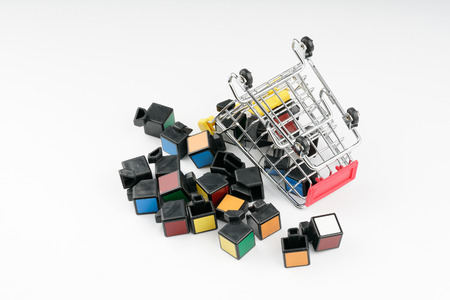 KUALA LUMPUR, MALAYSIA - OCTOBER 22, 2016: Toy trolley and broken rubic cube with white background