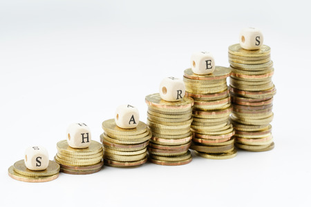 equidad: yellow coins stacking with finance bussiness concept.