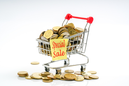 75 80: Trolley and coins with sale concept. Stock Photo
