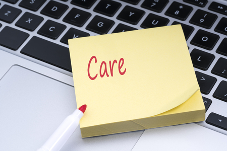health care provider: Sticky note with conceptual red text pasted on the keyboard