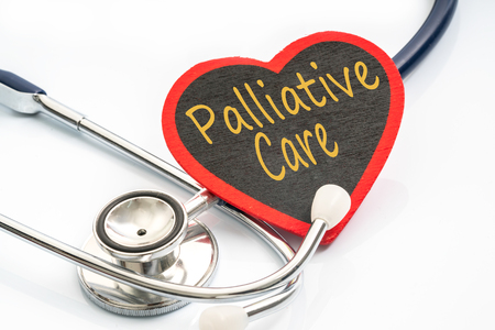 palliative: stethoscope and red love with medical conceptual text.