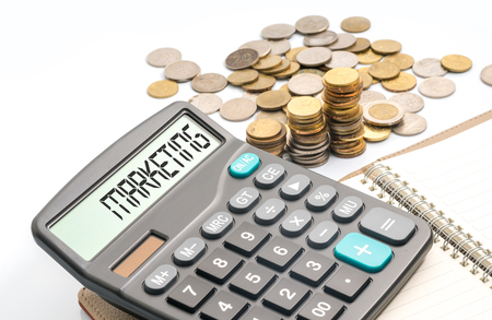 long term evolution: Coins and calculator with financial conceptual text
