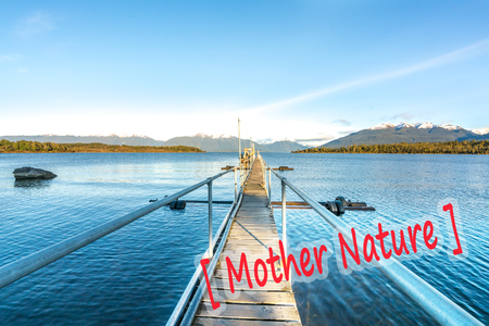 the bigger picture: Lake and wooden jetty with natural morning sunlight