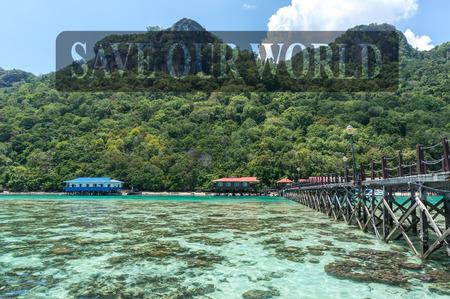 Wooden jetty and corals at a Boghey Dulang island, Sabah, Malaysia