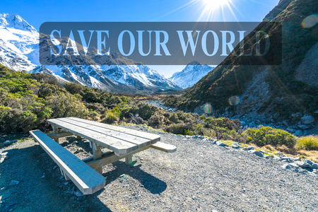 Resting wooden table and chair with sun flare at Mount Cook, New Zealand