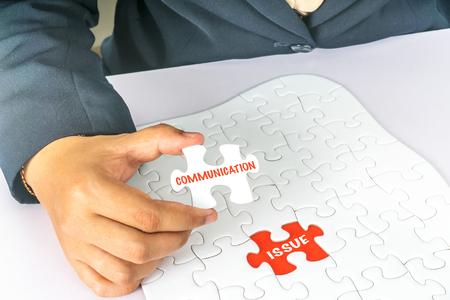 puzzle bianco con testo concettuale. Archivio Fotografico