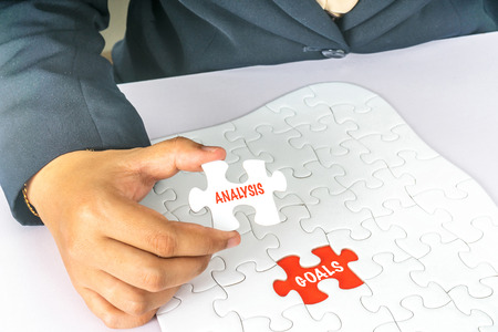 White jigsaw with text conceptual.