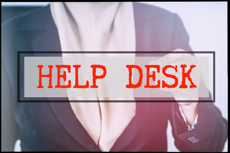 advertise with us: Hand and text HELP DESK with vintage background. Technology concept.