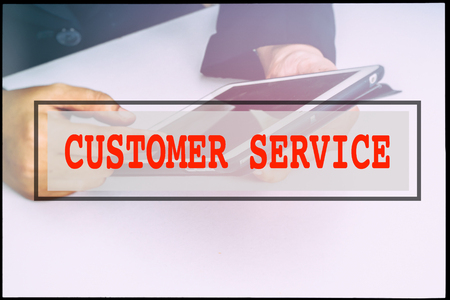 advertise with us: Hand and text CUSTOMER SERVICE with vintage background. Technology concept.