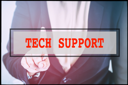 advertise with us: Hand and text TECH SUPPORT with vintage background. Technology concept.