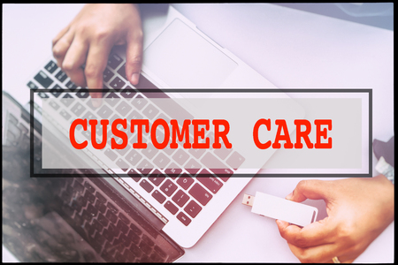 advertise with us: Hand and text CUSTOMER CARE with vintage background. Technology concept.