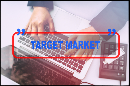 reach customers: Hand and text  TARGET MARKET with vintage background. Technology concept.