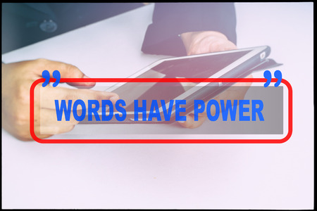 reach customers: Hand and text  WORDS HAVE POWER with vintage background. Technology concept.