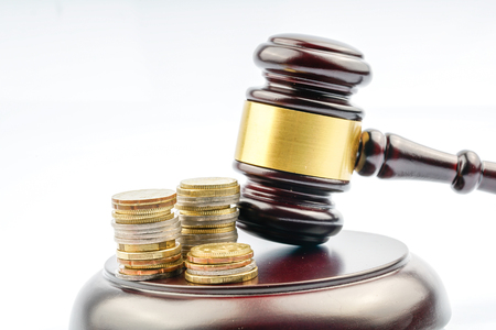 Gavel hammer and coins Stock Photo