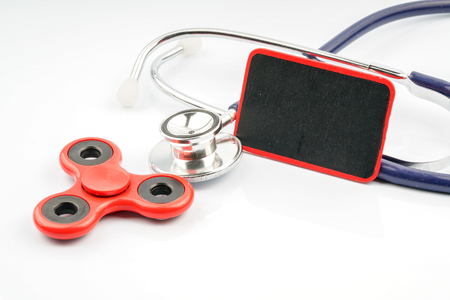 Fidget spinner and stethoscope with close up view.