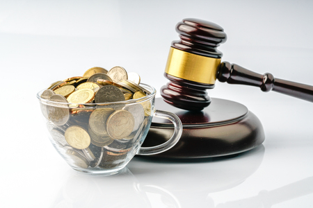 Coins and gavel with white background
