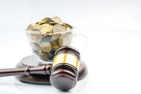 Gavel and coins with white background Stock Photo
