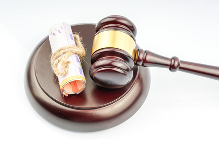 Gavel and money with white background Stock Photo