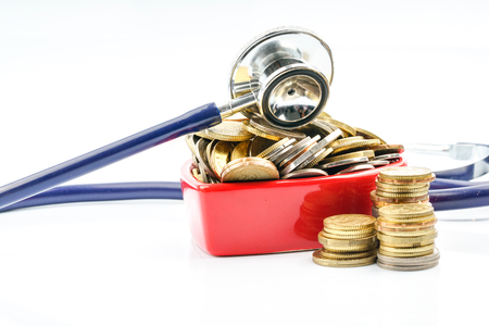 Coins and stethoscope with with background.