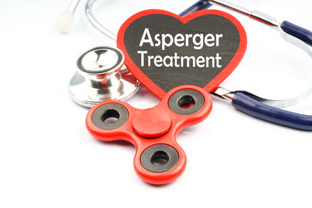 impaired: Fidget spinner and stethoscope with medical concept. Stock Photo