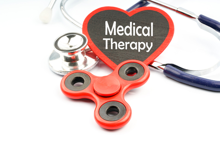 Fidget spinner and stethoscope with medical concept. Stock Photo