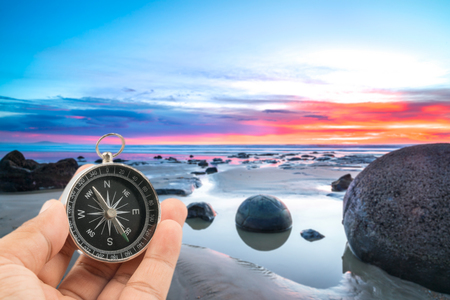 Compass with landscape background