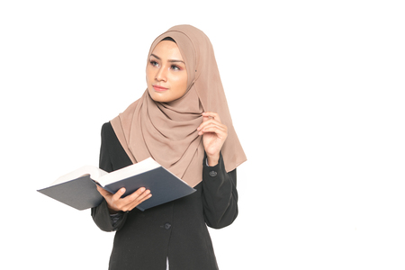 Hijab businesswoman with book. Education concept. 免版税图像