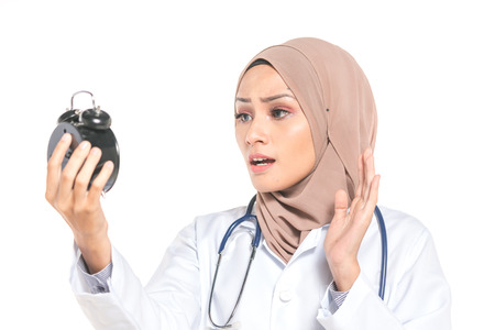 Hijab medical doctor with clock. Healthy and time management concept.