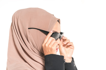 Hijab teenager wearing glaucona spec. Medical therapy concept.