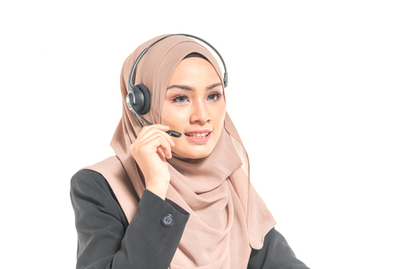 Beautiful teenager having communication by headphone