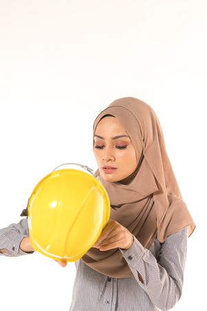 Hijab collage with safety helmet.