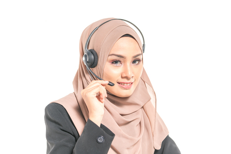 Beautiful teenager having communication by headphone