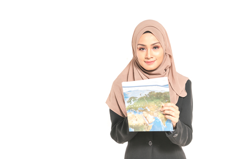 Hijab teenager hold a map. Trave; concept.