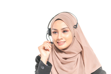 Hijab teenager wearing headphone Imagens