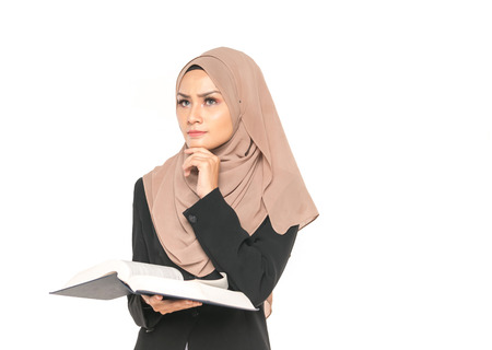 Hijab businesswoman with book. Education concept. Reklamní fotografie
