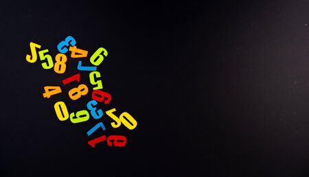 Colorful numbers on black background with educational concept.